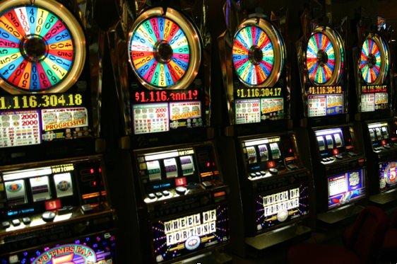 Photograph of 5 casino slot machines